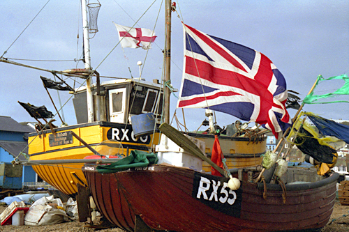 Fishing boats flying the flags at Hastings Sussex photographed by pop artist Trevor Heath