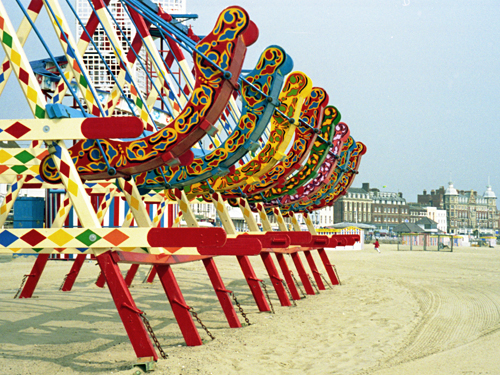 Swingboats, early morning, Weymouth beach, Dorset photographed by pop artist Trevor Heath