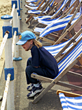 Girl and deck chairs, Weymouth photographed by artist Trevor Heath